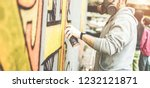 graffiti artist painting with... | Shutterstock . vector #1232121871