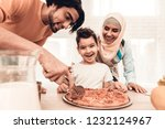 happy arabian family eating... | Shutterstock . vector #1232124967