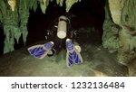 diver entering through the... | Shutterstock . vector #1232136484