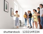 group of people with guide at... | Shutterstock . vector #1232149234