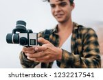 young handsome guy shoots a... | Shutterstock . vector #1232217541