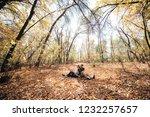 a man and a woman lie on a... | Shutterstock . vector #1232257657