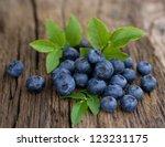 fresh bilberries on wooden... | Shutterstock . vector #123231175