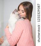portrait of a young brunette... | Shutterstock . vector #1232329387