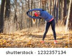 young woman doing stretching... | Shutterstock . vector #1232357134