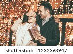 man keeps his girlfriend eyes... | Shutterstock . vector #1232363947