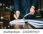 Stock photo partner lawyers or attorneys discussing a contract agreement successful businessmen hand putting 1232407417