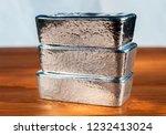 three cast silver bullion on a... | Shutterstock . vector #1232413024