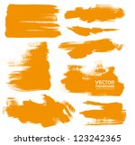 Hand-drawing orange textures of brush strokes in random shape