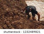 strong man in black sportswear... | Shutterstock . vector #1232489821