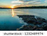 sun reflection forms a flame... | Shutterstock . vector #1232489974