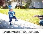 a cute little africa american... | Shutterstock . vector #1232598307