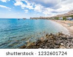 stegna beach with sunshades ... | Shutterstock . vector #1232601724