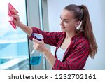 a young housewife in a shirt... | Shutterstock . vector #1232702161