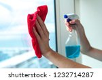 washing the windows in the... | Shutterstock . vector #1232714287