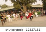 Tai Chi Exercising in the morning in Beijing, China in the Temple of Heaven park - stock photo