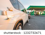 car at gas station with money... | Shutterstock . vector #1232732671