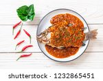 deep fried fish with chili sauce | Shutterstock . vector #1232865451