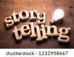 Wood Storytelling word with glowing light bulb. Storytelling idea
