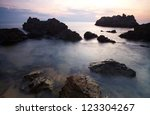 sea and rocks with sunset in... | Shutterstock . vector #123304267