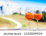 two glasses of delicious aperol ... | Shutterstock . vector #1233049924