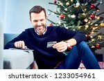 man paying for presents online...   Shutterstock . vector #1233054961