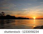 a beautiful sunset over the...   Shutterstock . vector #1233058234