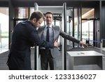 security man check businessman... | Shutterstock . vector #1233136027