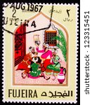 Small photo of FUJAIRAH - CIRCA 1967: A stamp printed in Fujairah shows four images from the story of Ali Baba , circa 1967.