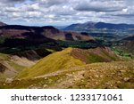 drak clouds moving over the... | Shutterstock . vector #1233171061