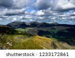 drak clouds moving over the... | Shutterstock . vector #1233172861