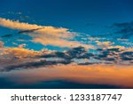 beautiful sunset. yellow clouds ... | Shutterstock . vector #1233187747