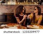 stylish women friends wearing...   Shutterstock . vector #1233209977