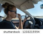 woman female driver uses a... | Shutterstock . vector #1233215554