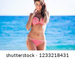 pretty slim girl at tropical... | Shutterstock . vector #1233218431