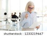 nervous middle aged old... | Shutterstock . vector #1233219667