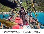 beautiful girl in hat relaxing... | Shutterstock . vector #1233237487
