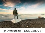 man standing over ice in... | Shutterstock . vector #1233238777