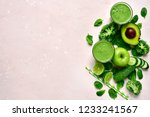 green vegetable smoothie in a... | Shutterstock . vector #1233241567