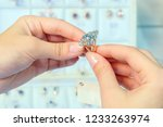 close up of a gold diamond ring ... | Shutterstock . vector #1233263974