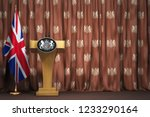 Podium speaker tribune with flags of Great Britain and UK coat of arms. Briefing or press conference of prime minister or queen of UK  Great Britain. 3d illustration