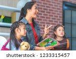 teacher is reading story book... | Shutterstock . vector #1233315457