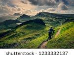 mountain biker riding through... | Shutterstock . vector #1233332137