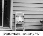 folding chair on a porch.   Shutterstock . vector #1233349747