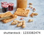 two tasty peanut butter toasts... | Shutterstock . vector #1233382474