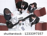 top view.handshake of... | Shutterstock . vector #1233397357