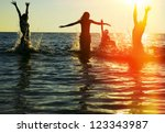 silhouettes of young group of... | Shutterstock . vector #123343987
