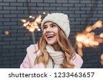 happy cute girl in winter hat... | Shutterstock . vector #1233463657