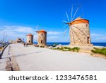 Small photo of Windmills at the seafront in the city of Rhodes in Rhodes island in Greece