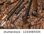 disassembled shotgun parts and... | Shutterstock . vector #1233485434